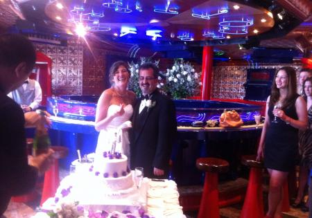 Happy couple with their cake on the CCL Freedom